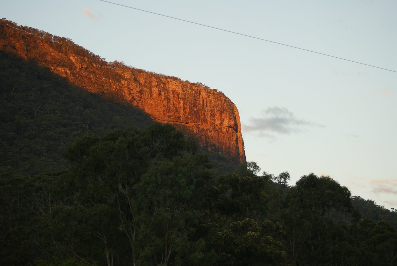 Buchan's Fort, the backdrop to Cave Rock Cottages at sunset