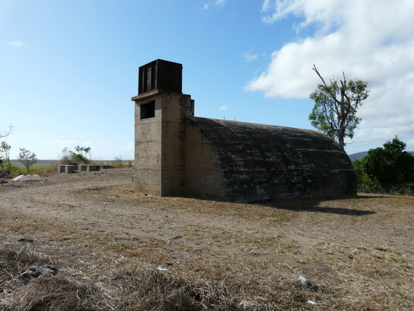 The reinforced concrete igloos remaining from the World War II Radar Station at Charlie's Hill are listed in the Queensland Heritage Register because of the site's historical and military significance.
