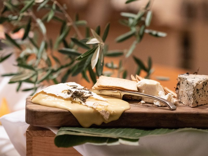 Cheese and crackers platter with olive branch