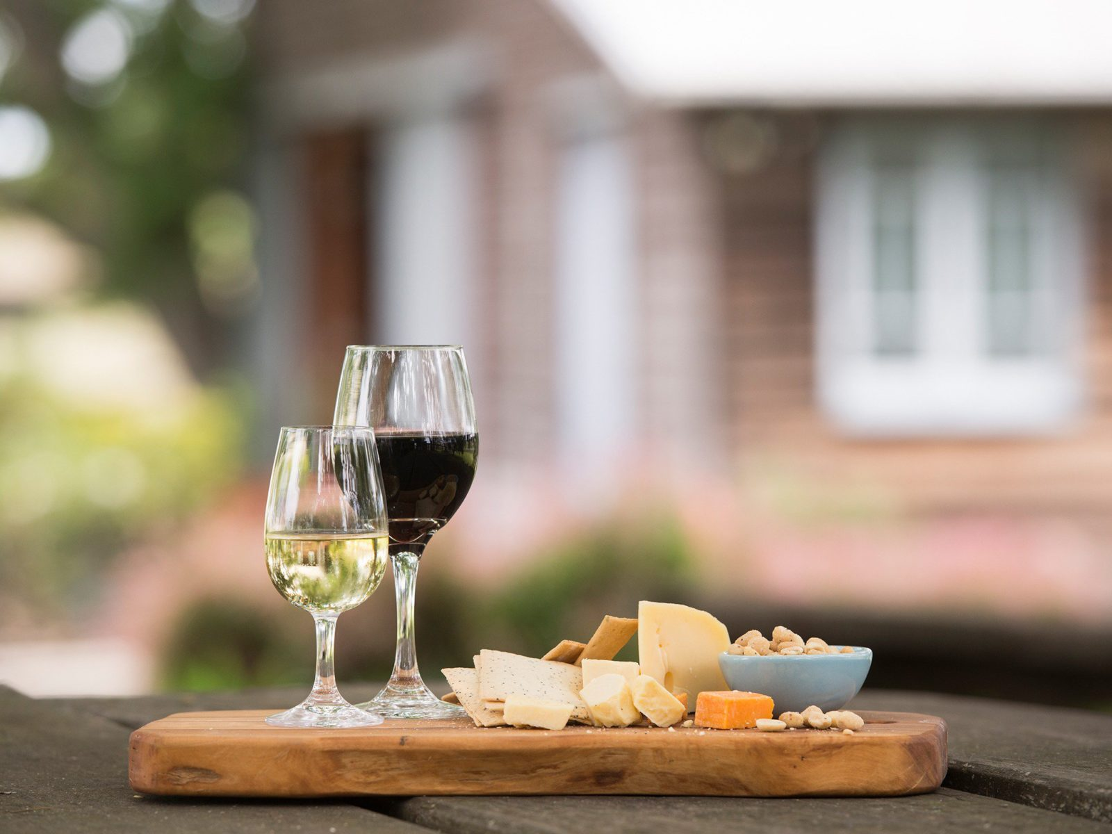 Image of cheese platter with 2 glasses of wine
