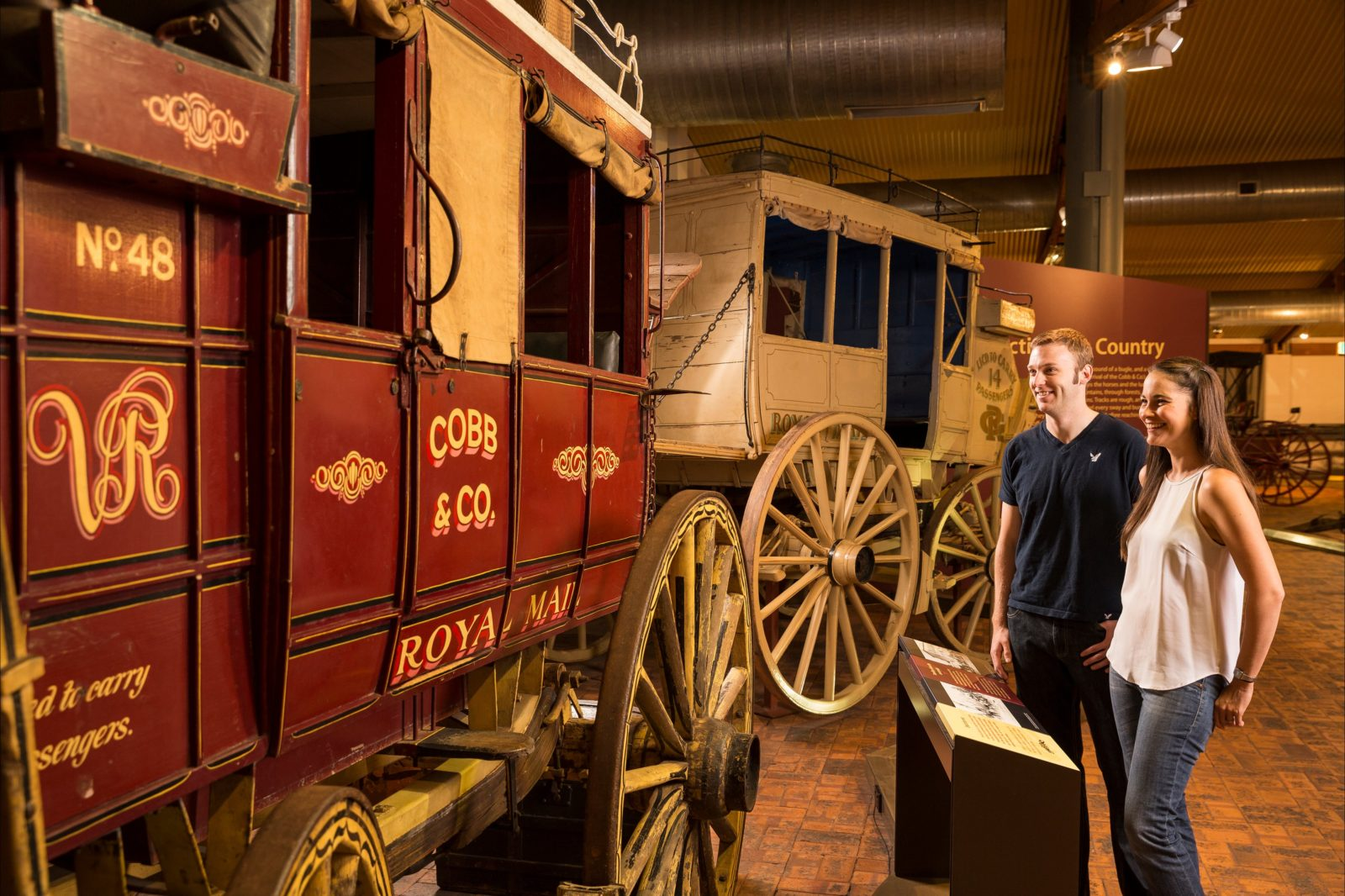 Young couple looking at National Carriage Collection