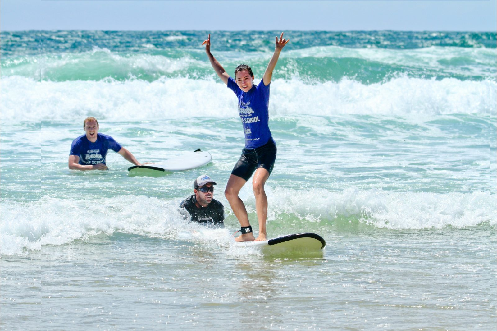 Surfing in the warm waters of the Sunshine Coast