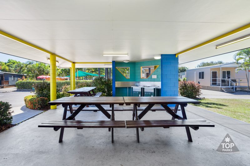 Barbecues and seating in Camp Kitchen at Coral Coast Tourist Park Townsville