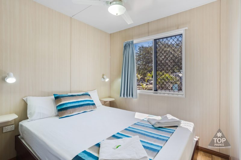 Image of Queen Bedroom in Deluxe Cabin at Coral Coast Tourist Park Townsville