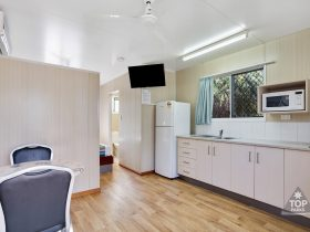 Photo of kitchenette/dining area of Deluxe Cabin at Coral Coast Tourist Park Townsville
