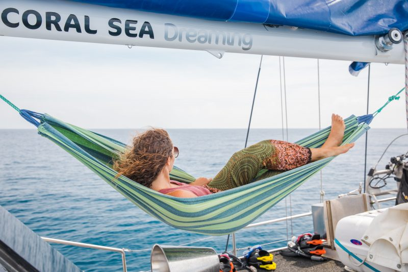 Relax on the deck - Cairns only overnight sailing experience