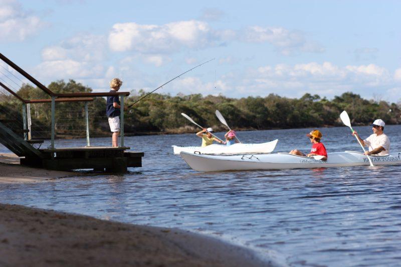 Paddling canoes and kayaks on Currimundi Lake