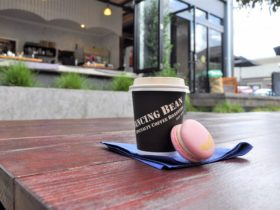 Photo of Coffee and Macaroon with Dancing Bean Espresso Bar in the background