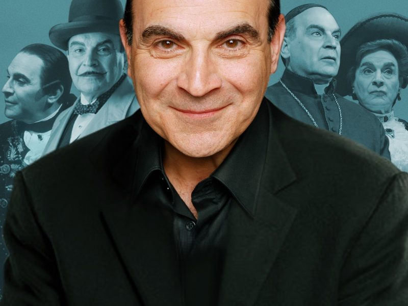 David Suchet with pictures of him playing characters in the background