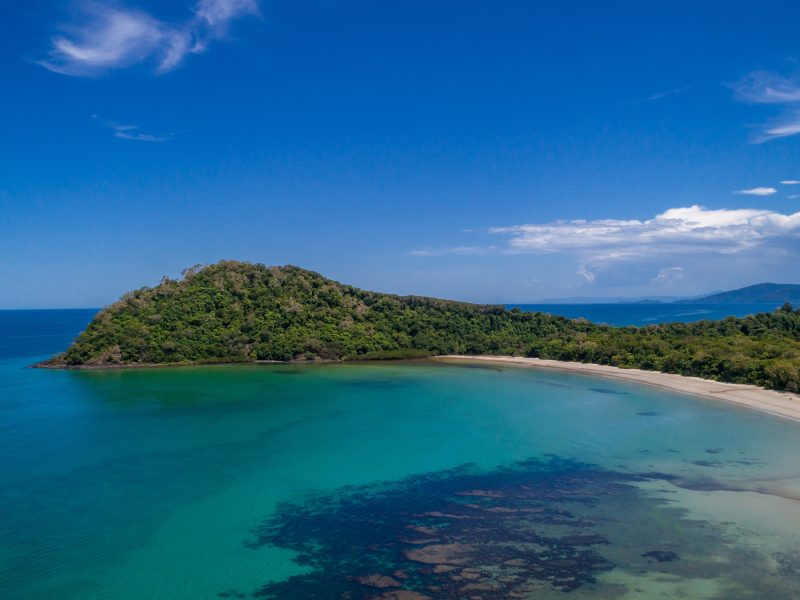 Aerial image of Cape Tribulation: beach, rainforest and reef meet.