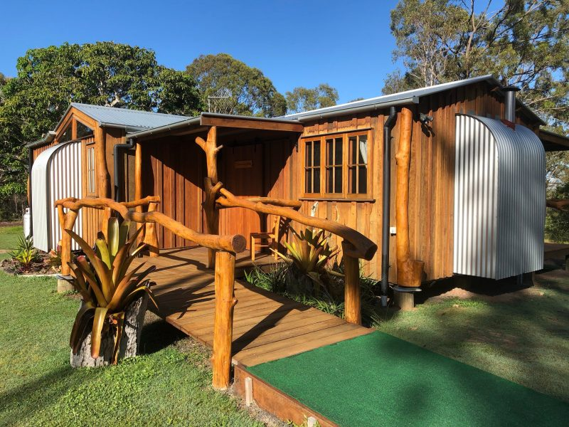 Mango Lodge - solid timber slab cabin on 75 acres adjoining 40 acre nature reserve kangaroos abound