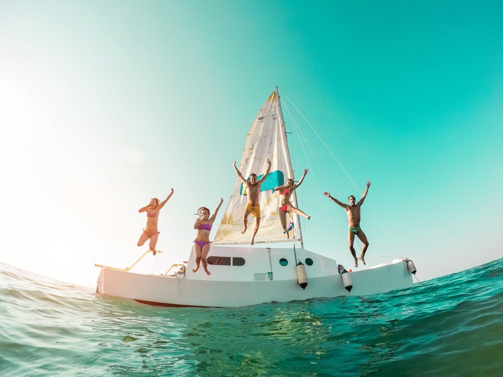 Group of friends sailing boat Fraser Island