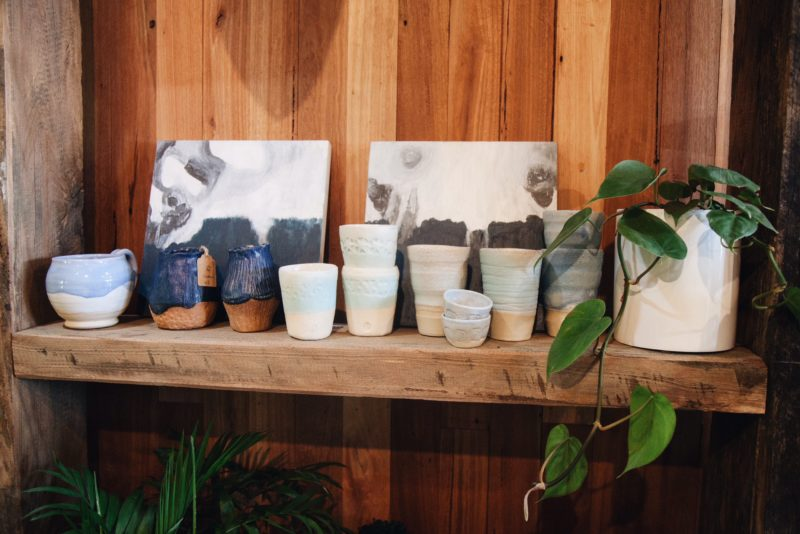Gathers locally crafted ceramics and local art sitting pretty on our wooden shelves