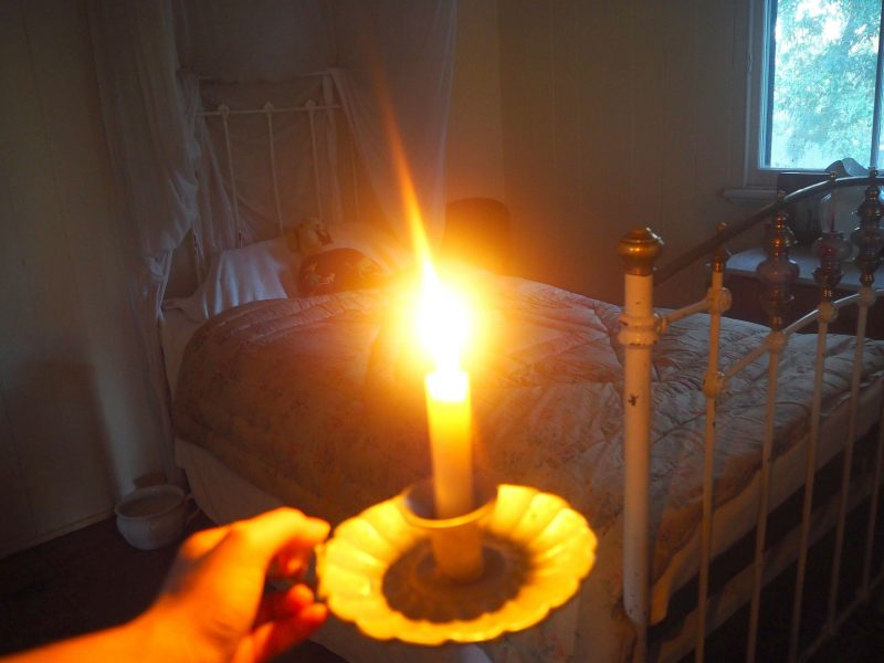 Candle beside bed