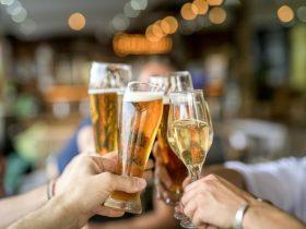 People cheersing drinks at Spicers Tamarind Retreat