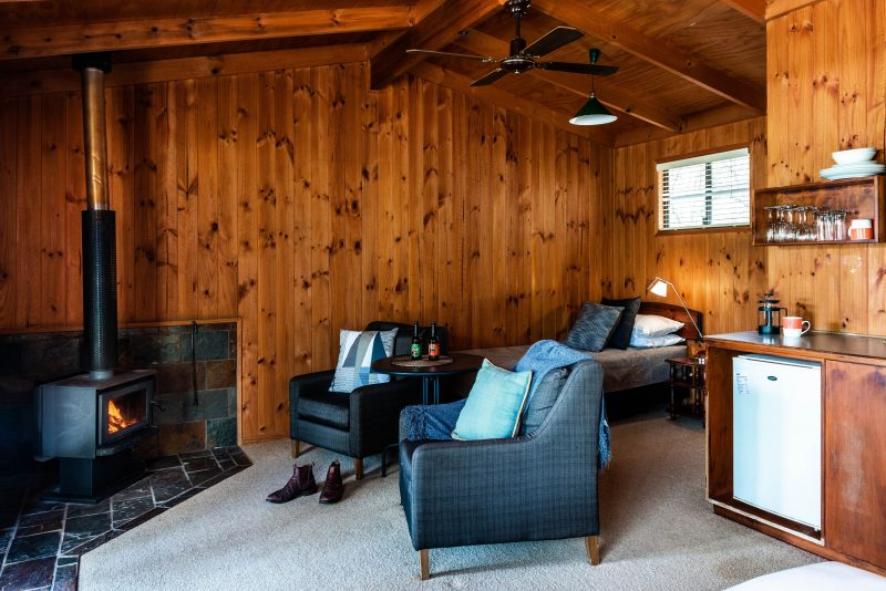 Enjoy the log fire in our Timber Cabin