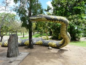 The Gudjuda Reference Group commissioned the large carpet snake sculpture Gubulla Munda Dreaming (2004), which was painted by aboriginal artists and stands on a sacred site, along with several plaques and a memorial stone, in Plantation Park, Ayr, North Queensland.