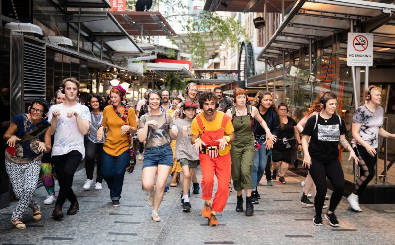Dani Disco leads a group of 60 sneaky people through Queen St Mall in Brisbane.