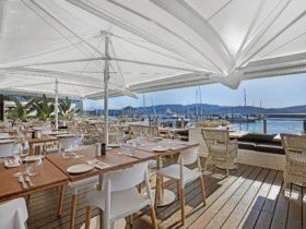 The Waterfront Deck –formal dining seating with stunning waterfront views.