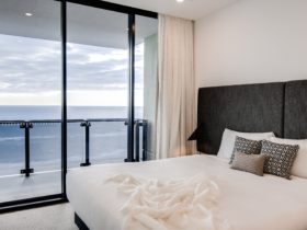 Spacious bedroom with ocean views from the window. you can lie in bed and see the ocean