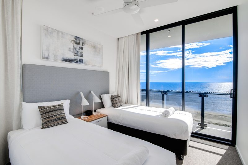 The second bedroom in a 3 bedroom oceanfront apartment. Beautiful views of the ocean and beach