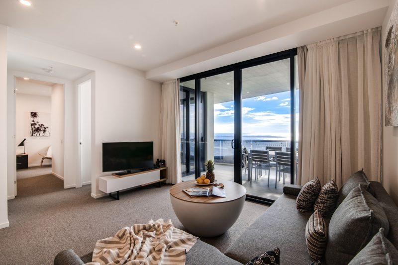 Spacious Living Area with Flat Screen TV, Premium Foxtel and a balcony with ocean views.