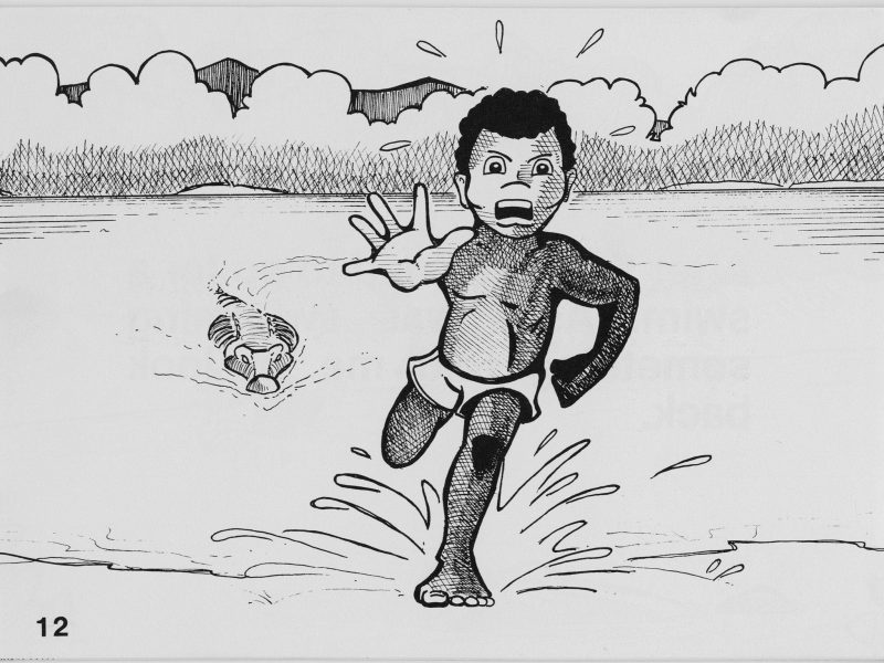child running away from crocodile in the water
