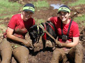 2 muddy girls and a dog at K-9