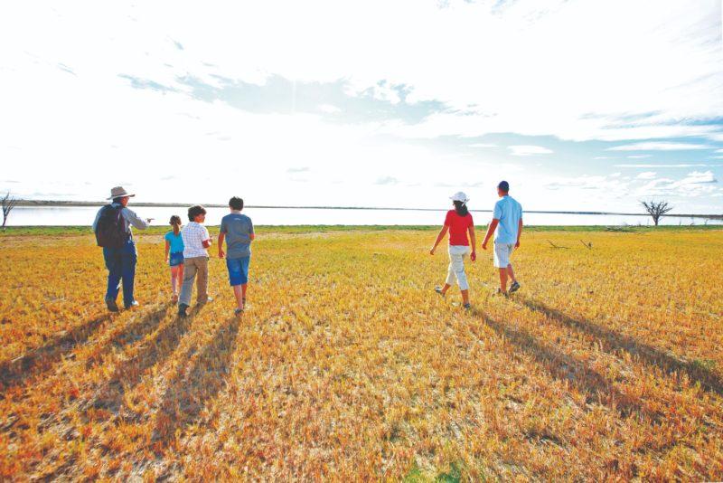 Family walking towards Lake Bindagolly