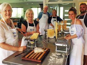 Cooking class participants experiencing making fresh pasta for the first time