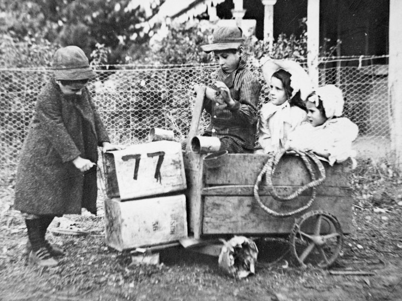 Children in billy cart made from packing cases and tin cans, Victoria, c1910. Museums Victoria.