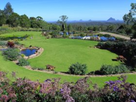 Waterfalls, ponds and stunning Glasshouse Mountain views create an awesome experience