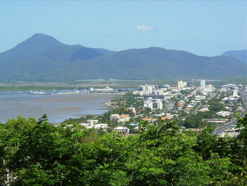Elevated view of Cairns city, Trinity Inlet and mountains in background.