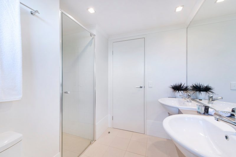Bathroom - his & hers vanities. Walk-in showers.