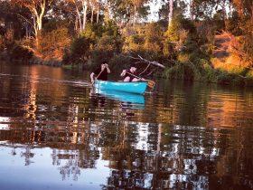 Canoe paddling river
