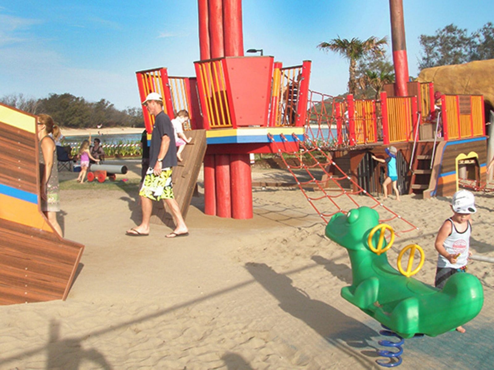 Children playing on gym equipment at the Palm Beach parklands