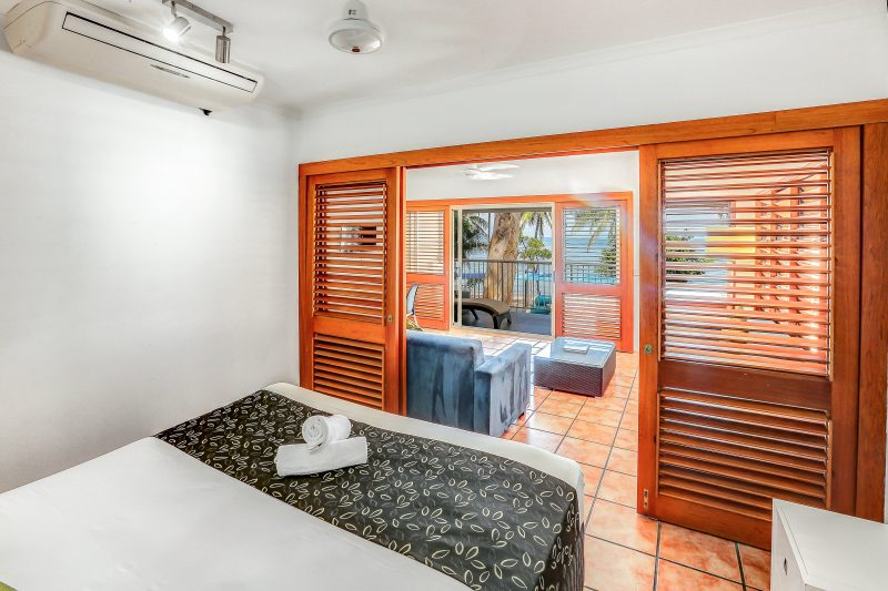 beach view spa suite from bedroom to balcony