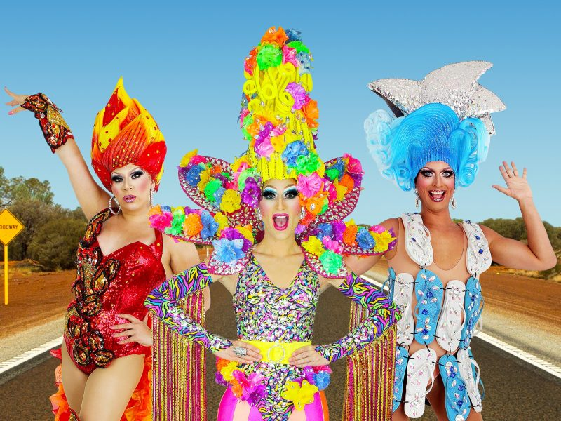 Three colourful and glamorously dress drag queens
