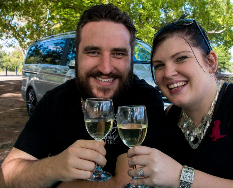 Image of couple with glass of wine