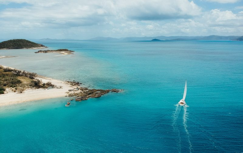 Dufour 56 Vanilla II sailing by Armit Island in the Whitsundays
