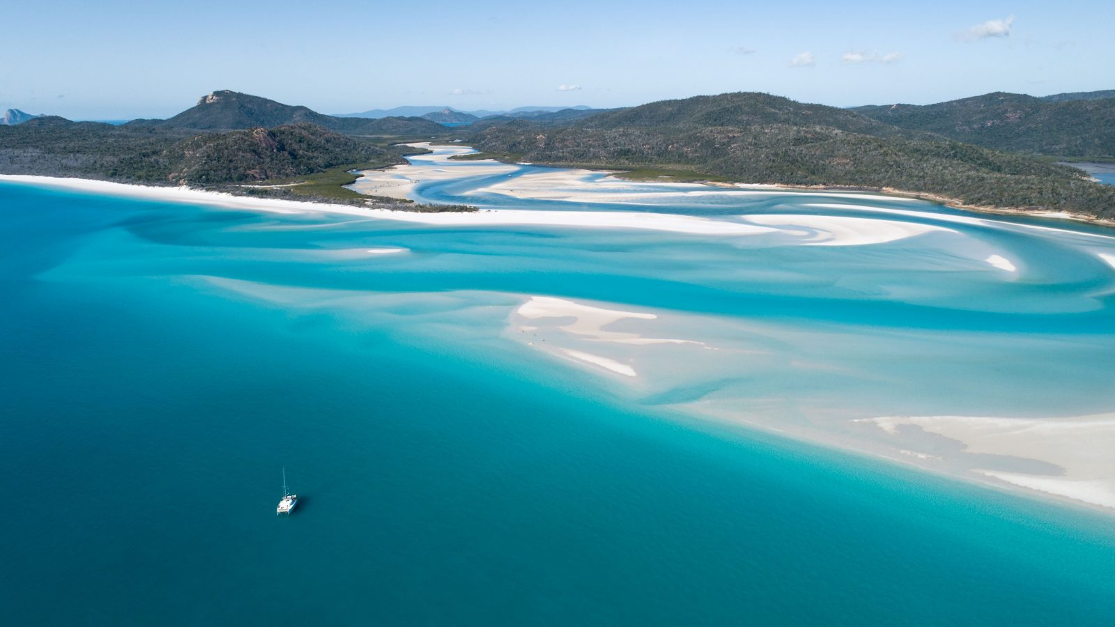 Spectacular white sandy beaches all yours to explore sailing the Whitsundays on a Bareboat Charter