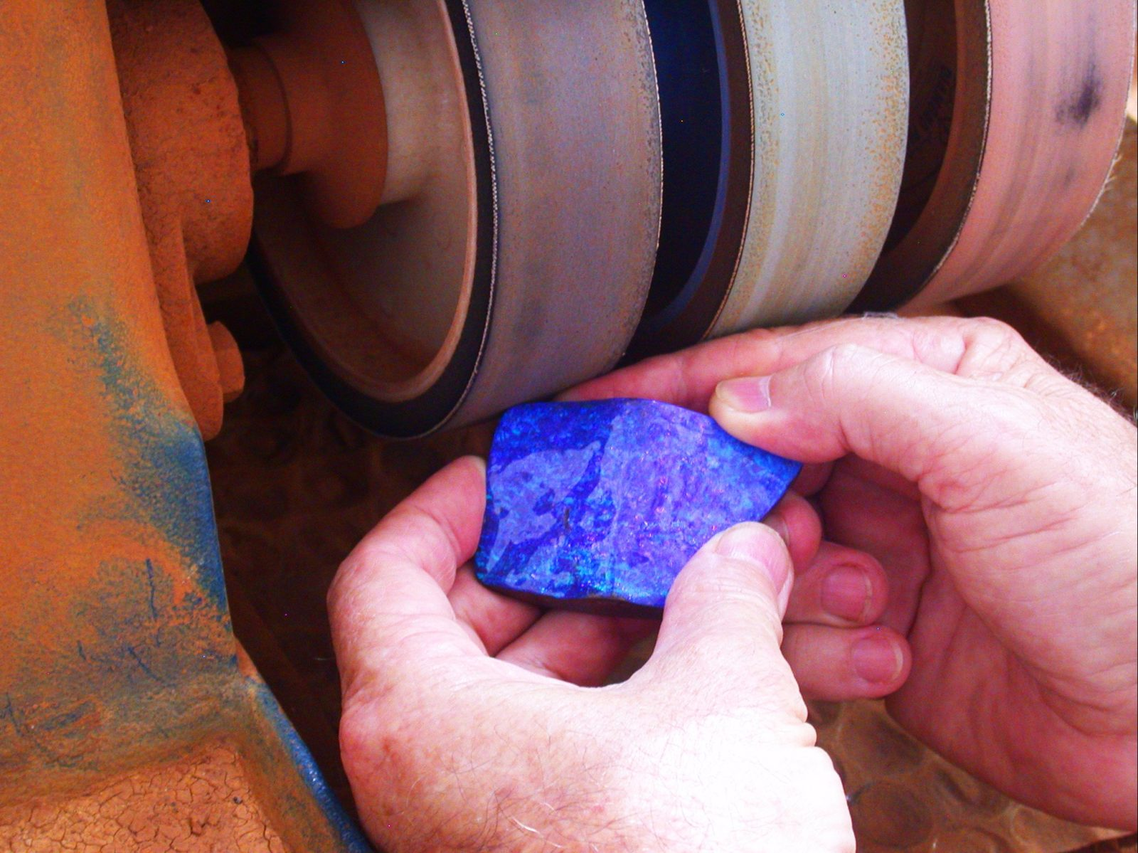 piece of opal being cut and polished