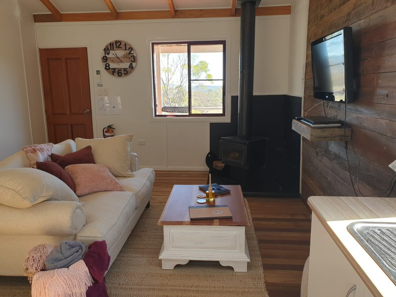 Cosy lounge area with tv and log fireplace