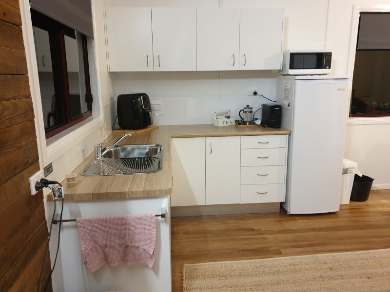 Full kitchenette complete with fridge, air fryer, kettle, microwave and all cooking utensils