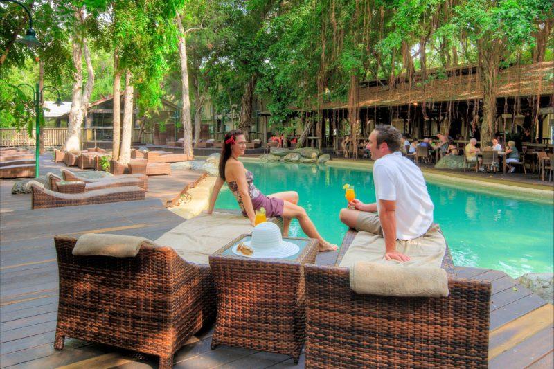 Ramada Resort Port Douglas couple near pool relaxing