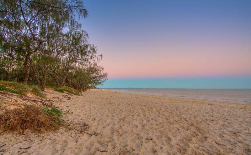 Pink and blue sun set at beach