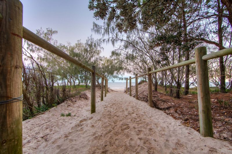 Entry walkway to beach at dusk