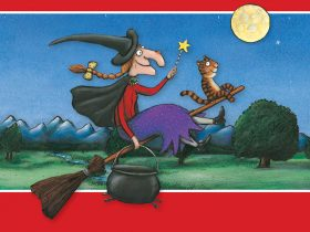 The witch and her cat are flying through the night sky with her cauldron