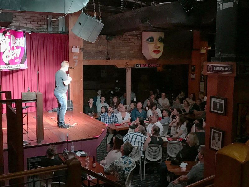 Comedian performing on stage