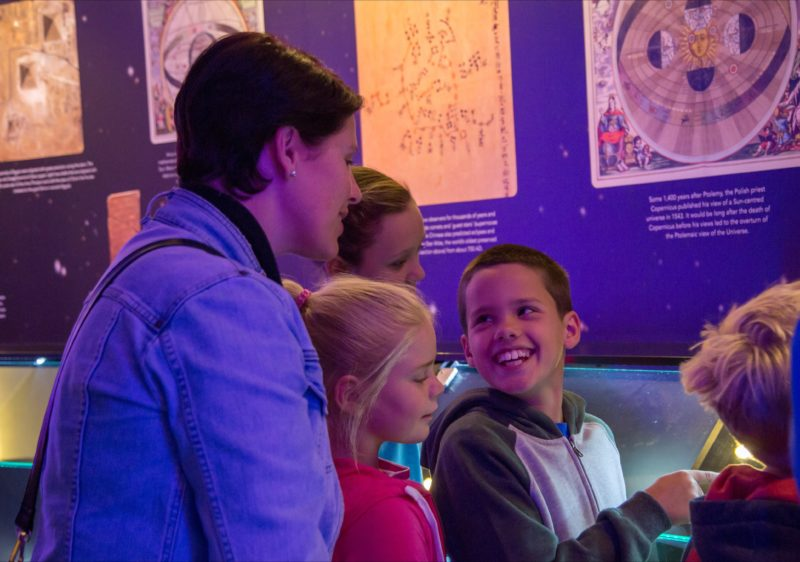 Family enjoying the Planetarium display zone